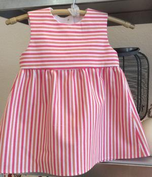 Rosarandig babyklänning